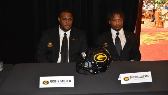 Grambling offensive lineman Justin Miller, left, and safety Guy Stallworth, right, are pictured at the 2016 SWAC Media Day on Friday in Birmingham, Alabama. Miller, a Ruston native, is one of the offensive leaders for 2016.