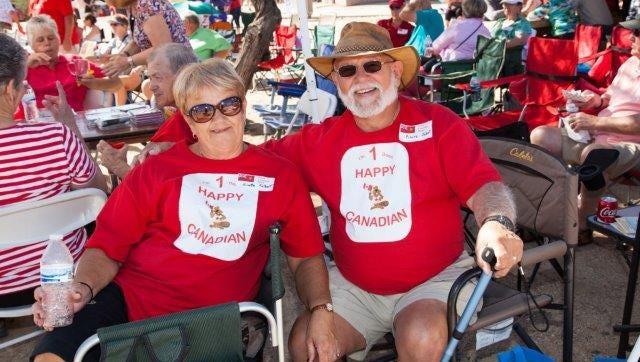 A couple enjoys an earlier Great Canadian Picnic.