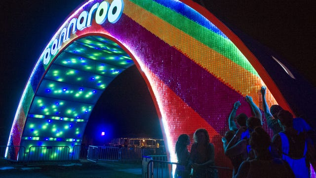 Festivalgoers remove small pieces of plastic from the Bonnaroo arch to have a keepsake during the final day of Bonnaroo 2015. Festivalgoers remove small pieces of plastic off the Bonnaroo arch to have a keepsake during the final day of Bonnaroo 2015.