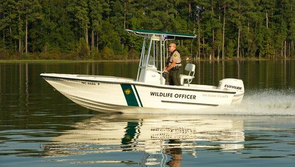 Officer Bryan Scruggs on patrol on Jordan Lake in Chatham