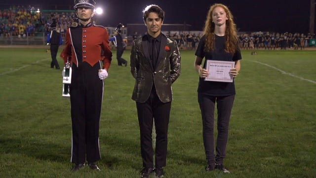 The Glen Ridge High School Marching Band finishes in first place in a competition at Brick Township High School on Saturday, Sept. 16. Pictured are, from left, Marching Band Field Captain Sam Landis, Drum Major Oliver Turiano, and Color Guard Captain Julia Sterling.