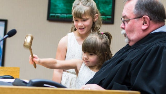 Delaware Circuit Court 4 Judge John Feick and young visitors to his courtroom celebrate National Adoption Day.