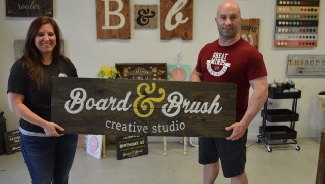 Owners Andrea and Greg Lormond of Board & Brush Youngsville