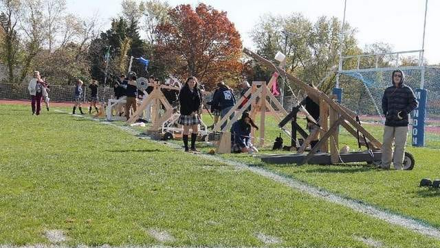 Pumpkins Soar in the Name of Science- The Physics Club at Donovan Catholic constructed mechanical catapults mostly out of wood with the objective to see which catapult design shot a softball.
