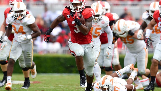 Georgia Bulldogs running back Todd Gurley (3) breaks a tackle by Tennessee Volunteers defensive back Brian Randolph (37) on his way to a touchdown during the second half at Sanford Stadium.