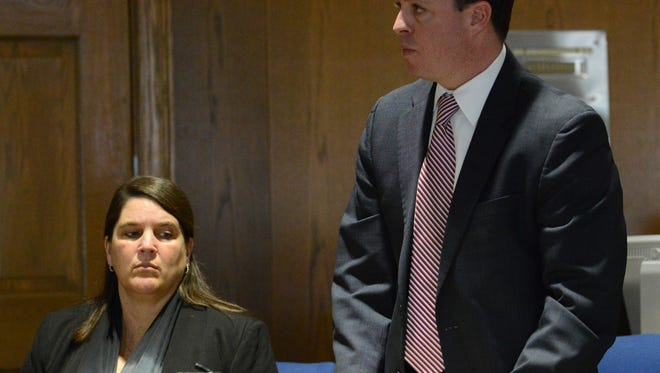 Bridget Kuhn, left, looks at her attorney James Tyack during a pretrial hearing in Fairfield County Common Pleas Court. Kuhn is accused of embezzling nearly $350,000 from Frazier Electric and the American Legion Post 11. She is the wife of former Lancaster Mayor Brian Kuhn.