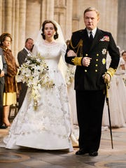 Claire Foy (left) as Elizabeth and Jared Harris as
