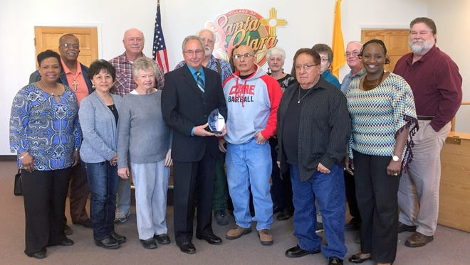 The Santa Clara Board of Trustees along with the mayor and members of the Fort Bayard Historical Society pose with members of the Office of African American Affairs on Friday afternoon. Mayor Richard Bauch of Santa Clara accepted an award and also was represented by Grant County Chamber of Commerce Director Scott Terry.