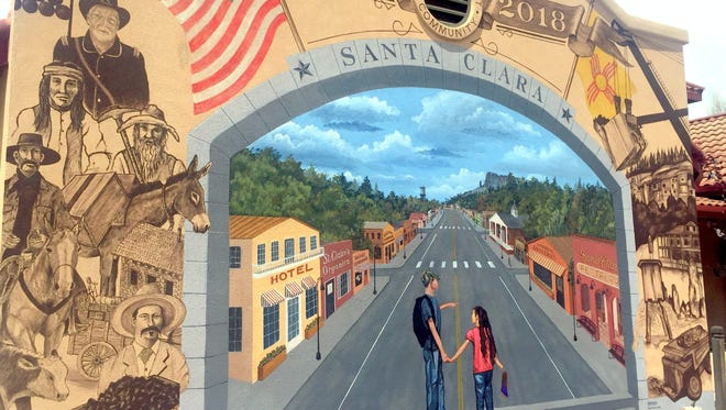 A mural was painted on the wall of Santa Clara's town hall by Doug Quarles. It depicts the past, present and future of the Village.
