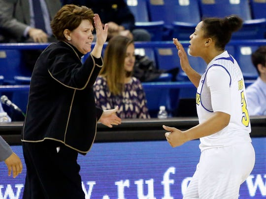 Delaware guard Erika Brown high-fives coach Tina Martin after her shot in the final seconds provided the difference in the Blue Hens' 67-65 win against Robert Morris at the Bob Carpenter Center on Thursday, Dec. 1, 2016.