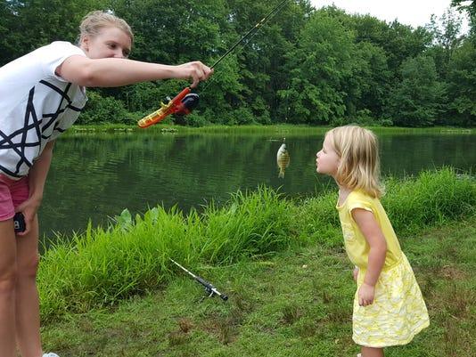 636386498773641185-girl-with-fish.jpg