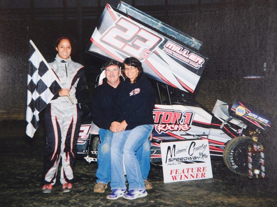 Sara Elrod with her parents, Bill and Donna