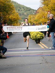 Runners in the Wineglass Marathon approach mile marker four in Bath Sunday, October 4.