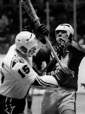 Maryland's Vic Generoux (15) and Kevin Parsons of the Griffins square off in a June 1974 game.
