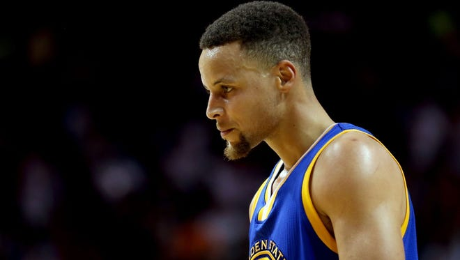 Stephen Curry looks on against the Miami Heat during the second half at American Airlines Arena.