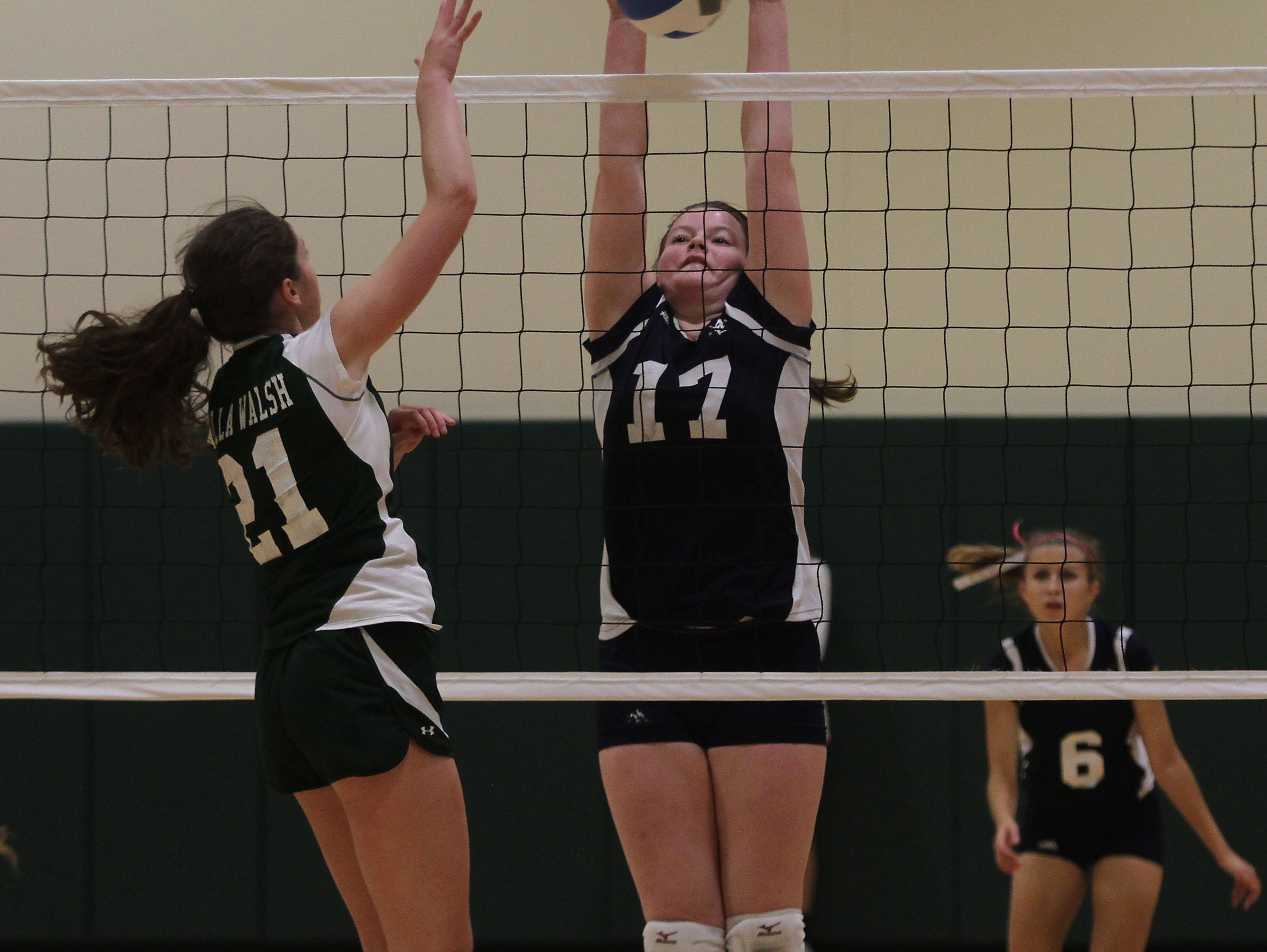 Villa Walsh's Maggie Pietrucha attempts a kills vs Morris Catholic's Reily O'Dowd in a Morris County Tournament volleyball preliminary matchup. Villa Walsh won the match to move on to the second round. October 2, 2015, Morristown, NJ.