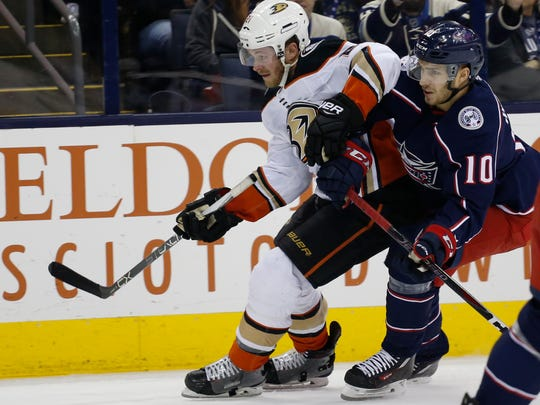 Anaheim Ducks' Chris Wagner, left, and Columbus Blue Jackets' Alexander Wennberg, of Sweden, chase the puck during the first period of an NHL hockey game Friday, Dec. 1, 2017, in Columbus, Ohio. (AP Photo/Jay LaPrete)