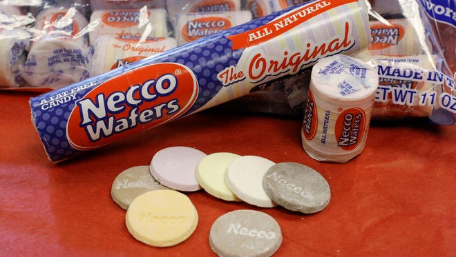 In this Oct. 14, 2009 file photo, Necco Wafers are displayed in Boston. The owner of a company that makes candies such as Necco wafers and Sweethearts has unexpectedly shut down operations at its Massachusetts plant. The Boston Globe reported Round Hill Investments LLC announced Tuesday, July 24, 2018, it is selling Necco brands to another confection manufacturer and closing down its Revere plant. (AP Photo/Charles Krupa, File)