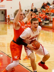 Blake Benningtgon of Twin Lakes drives to the basket against Max Wahl of Hamilton Heights in the semifinals of the Hoosier Conference tournament Friday, February 19, 2016, at Twin Lakes High School. Hamilton Heights defeated Twin Lakes 66-51.