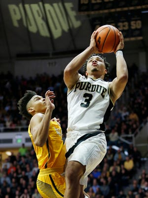 Carsen Edwards of Purdue gets past Micah Bradford of Valparaiso for a score Thursday, December 7, 2017, at Mackey Arena.