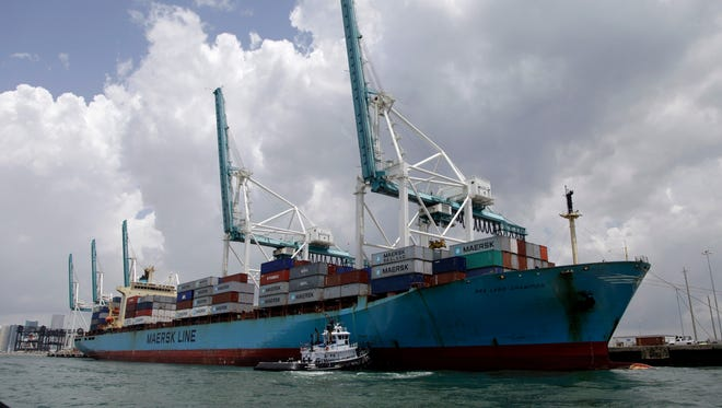 A Maersk freighter is loaded with shipping containers at the Port of Miami in Miami on May 18, 2012.