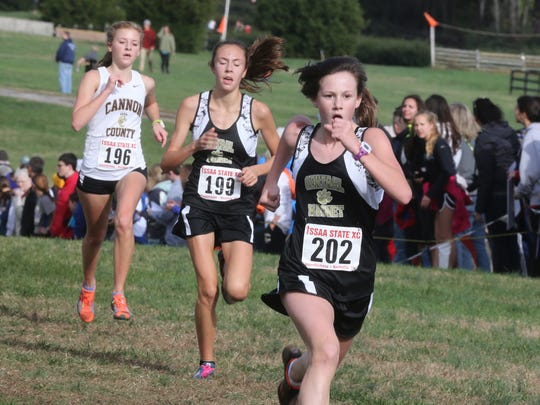 Central Magnet's Caroline Smith, Morgan Ouellette and Cannon County's Hannah Whited sprint to the finish line at the Class A/AA state meet on Saturday. Smith was 24th (21:24.19), Ouellette was 25th (21:26.74) and Whited was 26th (21:27.64).