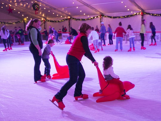 Festivalgoers ice skate during the opening night of