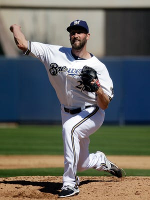 Milwaukee Brewers reliever Jim Henderson pitches in his first game since last May.