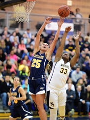 Jumping for a rebound Tuesday are Hartland's Whitney