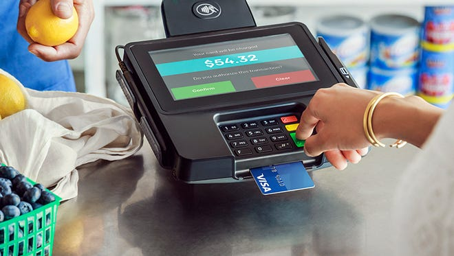A terminal capable of reading the new chip enabled credit and debit cards.