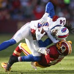Robert Woods #10 of the Buffalo Bills is tackled by cornerback DeAngelo Hall #23 of the Washington Redskins.