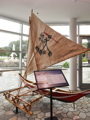 "A Chamoru Sakman outrigger canoe replica called ""Tasi"" is displayed at the Guam Museum in Hagåtña on June 29, 2017."