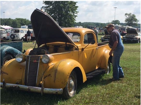 Bill Snodgrass of Nevada, Ohio, admired a 1938 Studebaker Coupe Express Truck Friday at Summit Motorsports Park where it and more than 700 vehicles in a collection owned by Ron Hackenberger of Norwalk are being auctioned.