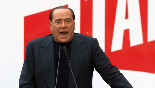Former Italian Premier Silvio Berlusconi addresses supporters during a demonstration in front of his residence in Rome.
