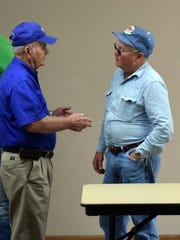 Rankin talks with local farmer.
