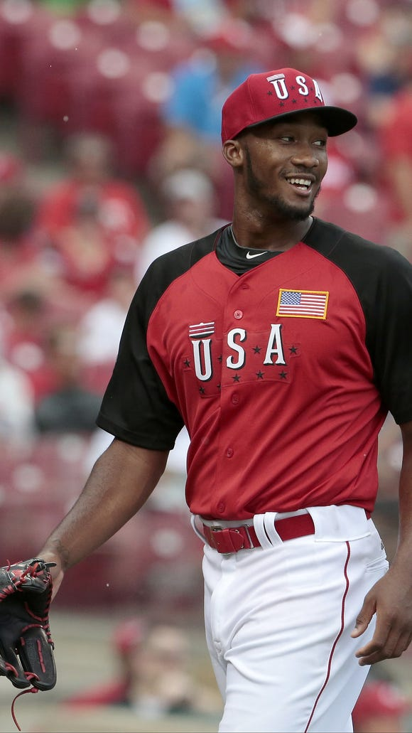 Reds prospect Amir Garrett smiles after the third out of the top of the third inning.