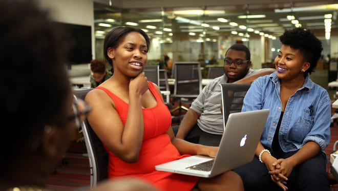 """Founders of The Irate 8, Ashley Nkadi (left) and Brittany Bibb, meet with the United Black Student Association at Langsam Library at the University of Cincinnati to discuss programs for """"Sam DuBose Week"""" on campus."""