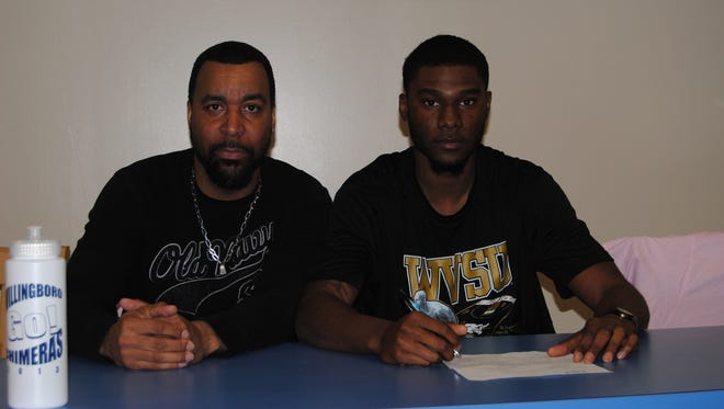 Awwal Reid of Willingboro signs his National Letter of Intent with coach Jeff Haddock by his side
