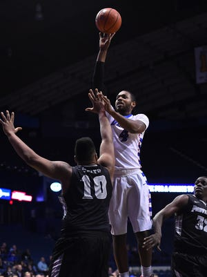 DePaul Blue Demons forward Myke Henry (4) shoots the ball against Providence Friars forward Quadree Smith (10) during the first half at Allstate Arena.