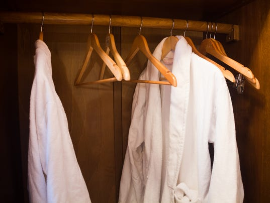 White Hotel gown on a hanger in the wardrobe