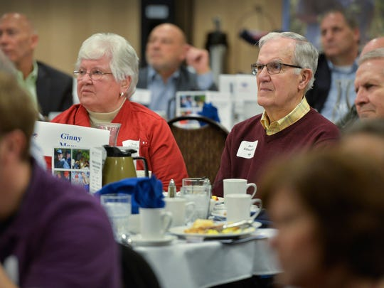 """Lois and David Klinefelter listen during Andy Marso's speech Thursday morning, March 17, at the Friends of Scouting Leadership Breakfast in the St. Cloud Holiday Inn Hotel & Suites. The parents of murdered St. Joseph Police Officer Brian Klinefelter, were a big part of Marso's book, """"The Klinefelter Legacy: A Story of Faith, Family and Forgiveness."""""""