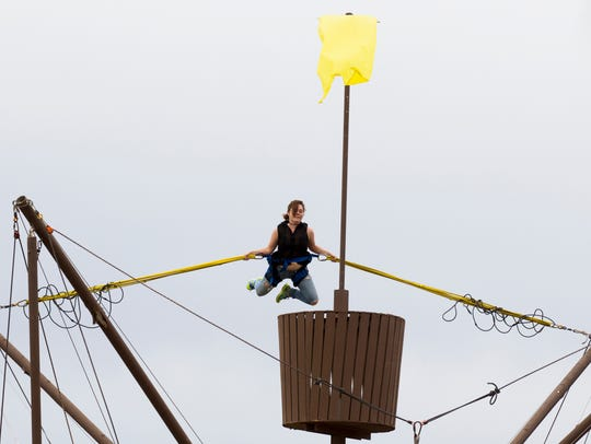 Brianna Campbell, 23, jumps on a trampoline ride during