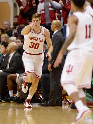 Indiana forward Collin Hartman (30) thanks guard Devonte Green (11) for the assist after Hartman's 3-pointer against Eastern Michigan during an NCAA college basketball game in Bloomington, Ind., Friday, Nov. 24, 2017.