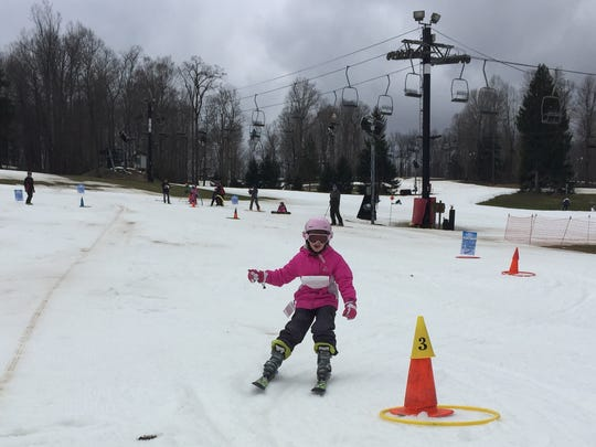 Seven-year-old skier Alexis Cawrse forgoes poles as she navigates around obstacles during the Kids' Challenge at the 56th annual Ski Carnival at Snow Trails on Saturday.