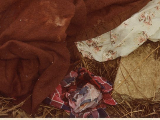 A photo from a 1981 crime scene of a blanket, sheet