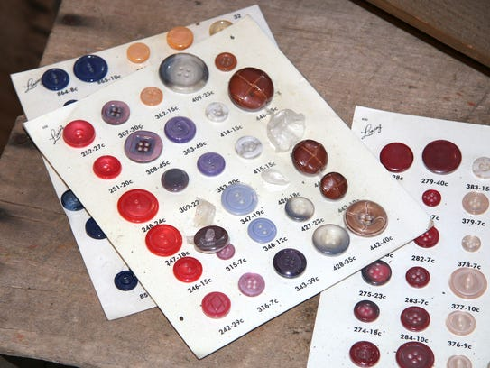 Buttons from one of the Lansing button companies are