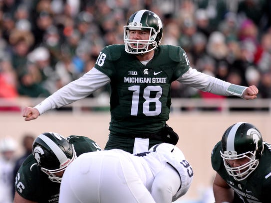 Connor Cook gets the offense lined up before a play