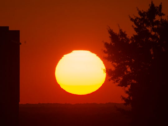 The sun sets on Friday, Sept. 30, 2016, in Montgomery,