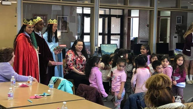 Members of the Burke Catholic Spanish Club welcomed preschoolers from House on the Hill Day Care Center for the Feast of Three Kings celebration. 23 children of migrant workers spent the afternoon making crafts, hearing stories, and visiting with the three kings.