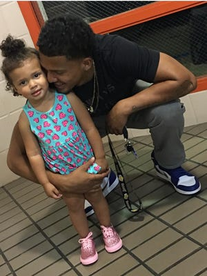 Jamal Hicks says he's playing football at CSU to give both himself and his 2-year-old daughter, Kamilah, a better life.
